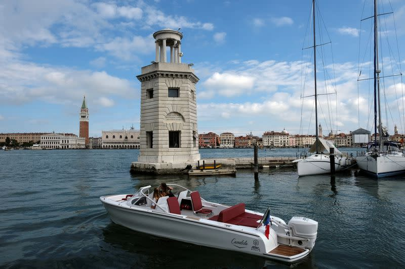 A new Swedish-designed electric boat is tested during the Salone Nautico in the lagoon city of Venice