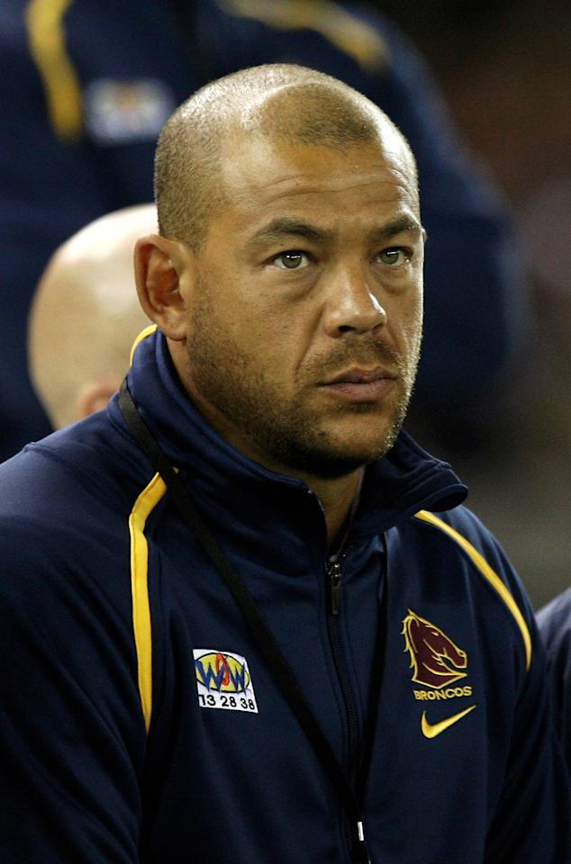MELBOURNE, AUSTRALIA - SEPTEMBER 26:  Australian cricketer Andrew Symonds watches from the Broncos bench during the second NRL Preliminary Final match between the Melbourne Storm and the Brisbane Broncos at Etihad Stadium on September 26, 2009 in Melbourne, Australia.  (Photo by Quinn Rooney/Getty Images)