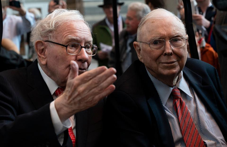 Warren Buffett (L), CEO of Berkshire Hathaway, and vice chairman Charlie Munger attend the 2019 annual shareholders meeting in Omaha, Nebraska, May 3, 2019. (Photo by Johannes EISELE / AFP)