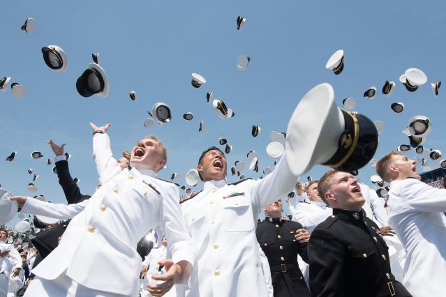 <p>U.S. Naval Academy midshipmen celebrate during their graduation ceremony in Annapolis, Md., on May 25, 2018. (Photo: Jim Watson/AFP/Getty Images) </p>