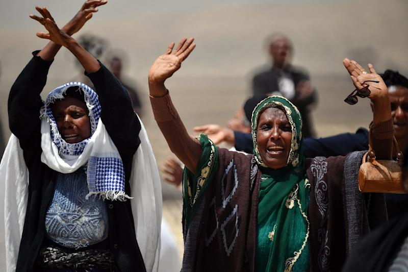 Distraught relatives at the site of an Ethiopian Airlines Boeing 737 MAX 8 plane crash that killed 157 people (AFP Photo/TONY KARUMBA)
