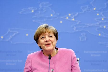 Germany's Chancellor Merkel briefs the media during a EU leaders summit in Brussels