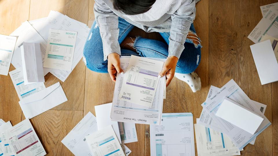 woman reviewing her personal finance paperwork