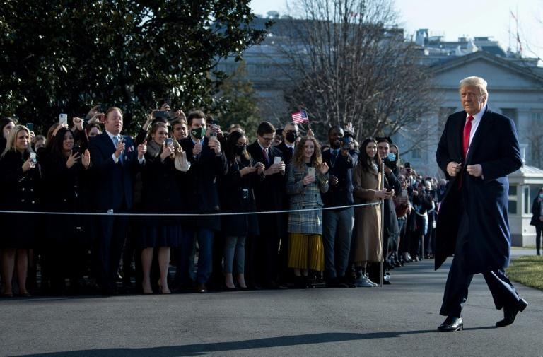 US President Donald Trump walks by supporters outside the White House on January 12, 2021 in Washington, DC before his departure to Alamo, Texas