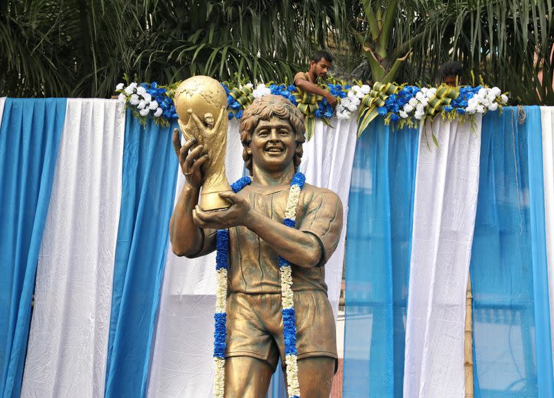 A garlanded statue of Argentine soccer great Diego Maradona is seen before a prayer meeting, in Kolkata