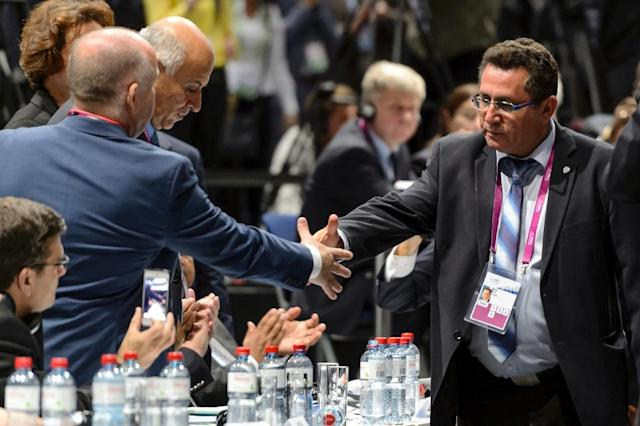 Israeli football chief Ofer Eini (right) shakes hands with his palestinian counterpart Jibril Rajoub during the 65th FIFA Congress in Zurich, on May 29, 2015 (AFP Photo/Fabrice Coffrini)