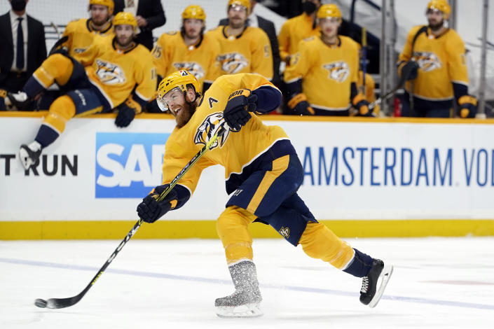 FILE - In this May 21, 2021, file photo, Nashville Predators defenseman Ryan Ellis shoots during the second period in Game 3 of an NHL hockey Stanley Cup first-round playoff series against the against the Carolina Hurricanes in Nashville, Tenn. The Philadelphia Flyers finally landed a premier defenseman when the acquired Ryan Ellis in a trade with Nashville. The Flyers think he can regain the form that made him one of the NHL's best defenseman — a position of need for the team for a while. (AP Photo/Mark Humphrey, File)