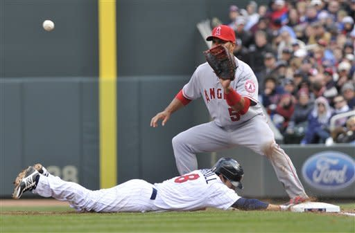 Wilson wins Angels debut, 5-1 in Twins home opener