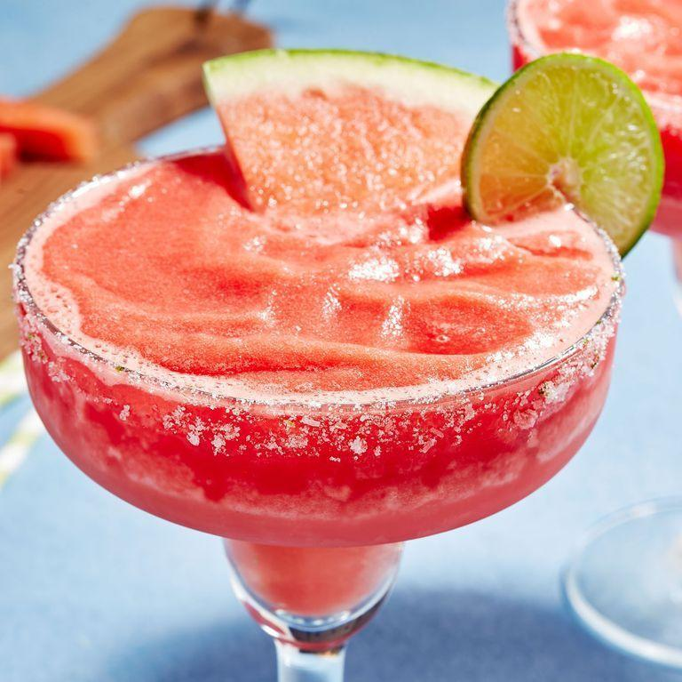 """<p>This recipe takes the two most refreshing parts of a cookout, fresh watermelon and an ice cold cocktail and combines them into a delicious, fruity treat.</p><p>Get the recipe from <a href=""""https://www.delish.com/cooking/recipe-ideas/a22604091/frozen-watermelon-margaritas-recipe/"""" rel=""""nofollow noopener"""" target=""""_blank"""" data-ylk=""""slk:Delish"""" class=""""link rapid-noclick-resp"""">Delish</a>.</p>"""