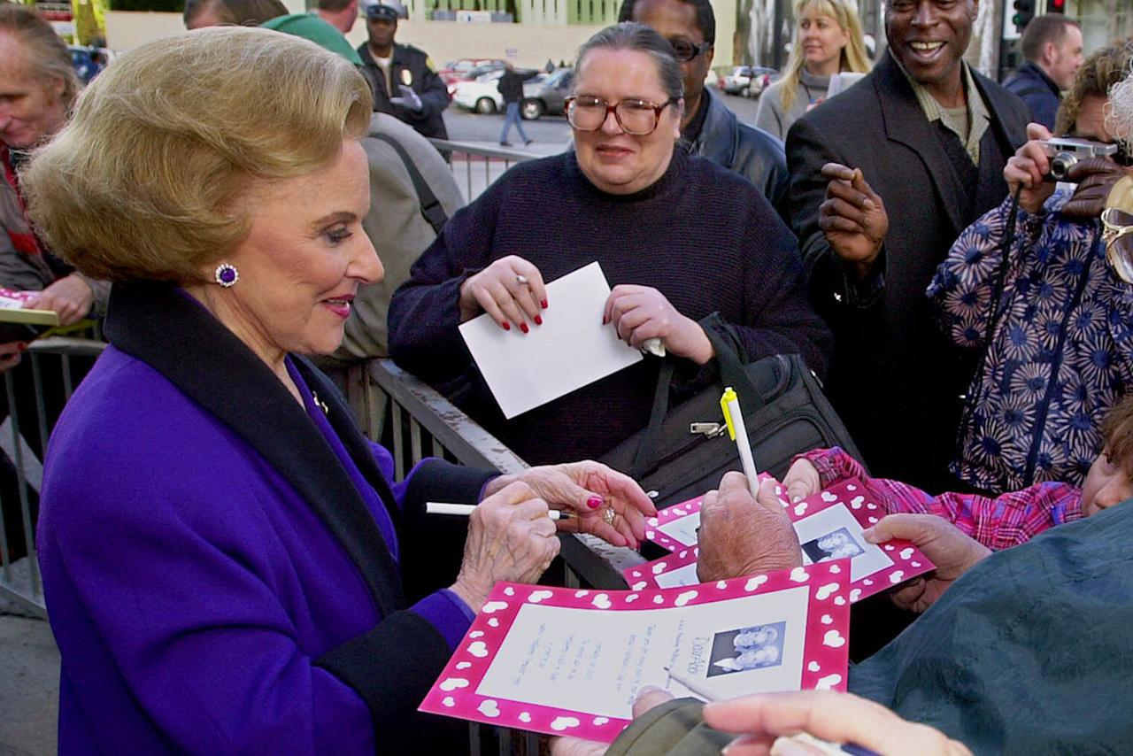 "FILE - In this Feb. 14, 2001 file photo, ""Dear Abby"" advice columnist Pauline Friedman Phillips, 82, known to millions of readers as Abigail van Buren, signs autographs for some of dozens of fans after the dedication of a ""Dear Abby"" star on the Hollywood Walk of Fame in Los Angeles. Phillips, who had Alzheimer's disease, died Wednesday, Jan. 16, 2013, she was 94. Phillips' column competed for decades with the advice column of Ann Landers, written by her twin sister, Esther Friedman Lederer. Their relationship was stormy in their early adult years, but later they regained the close relationship they had growing up in Sioux City, Iowa. The two columns differed in style. Ann Landers responded to questioners with homey, detailed advice. Abby's replies were often flippant one-liners. (AP Photo/Reed Saxon)"