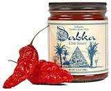 """<p>Dabka Chili</p><p><strong>$12.00</strong></p><p><a href=""""https://www.dabkachili.com/dabkachili/products/dabkachili"""" rel=""""nofollow noopener"""" target=""""_blank"""" data-ylk=""""slk:Shop Now"""" class=""""link rapid-noclick-resp"""">Shop Now</a></p><p>The best condiment we've had in a while! Made with a base of Roma and sun dried tomatoes and flavored with loads of Middle Eastern spices and a little kick from ghost peppers. Use it in marinades or simply slathered on pita bread and topped with fresh feta. Yum!</p>"""