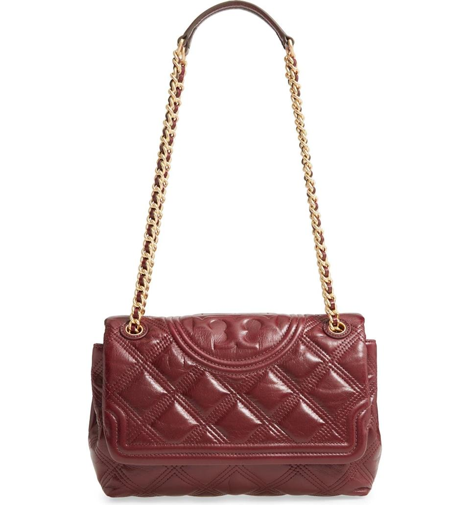 <p><span>Tory Burch Fleming Soft Leather Clutch</span> ($405, originally $578)</p>