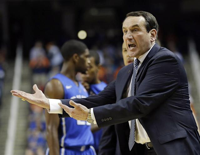 Duke head coach Mike Krzyzewski reacts after being called for a technical foul during the first half of an NCAA college basketball game against Virginia in the championship of the Atlantic Coast Conference tournament in Greensboro, N.C., Sunday, March 16, 2014. (AP Photo/Gerry Broome)