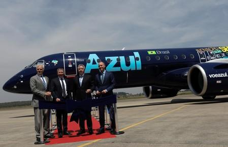 Neeleman, founder of Azul SA, Rodgerson, CEO of Azul SA, Slattery, head of commercial aviation at Brazilian planemaker Embraer and Kelly, CEO and Executive Director of AerCap attend an event in Sao Jose dos Campos