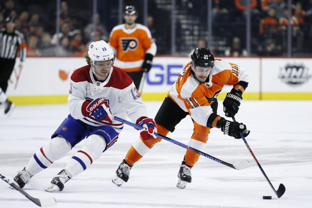 Philadelphia Flyers' Travis Konecny (11) and Montreal Canadiens' Max Domi (13) battle for the puck during the second period of an NHL hockey game, Thursday, Nov. 7, 2019, in Philadelphia. (AP Photo/Matt Slocum)