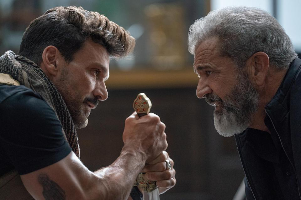 "Stuck in a time loop on the day he's murdered, a former special forces agent (Frank Grillo left) goes up against the head (Mel Gibson) of a government program in the action film ""Boss Level."""