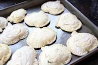 "<p>If you want to make a cute and savory appetizer, these puff pastries are for you! Filled with creamy spinach and sharp cheddar cheese, they're super easy to make and can be frozen ahead of time.</p> <p><strong>Get the recipe:</strong> <a href=""https://www.halfbakedharvest.com/jack-o-lantern-pastries/"" class=""link rapid-noclick-resp"" rel=""nofollow noopener"" target=""_blank"" data-ylk=""slk:jack-o'-lantern spinach-stuffed pastries"">jack-o'-lantern spinach-stuffed pastries</a></p>"