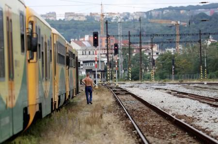 A man walks past a train at Bubny railway station in Prague