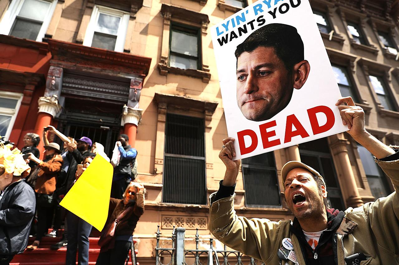 <p>Dozens of health care activists protest in front of a Harlem charter school before the expected visit of House Speaker Paul Ryan on May 9, 2017 in New York City. (Photo: Spencer Platt/Getty Images) </p>