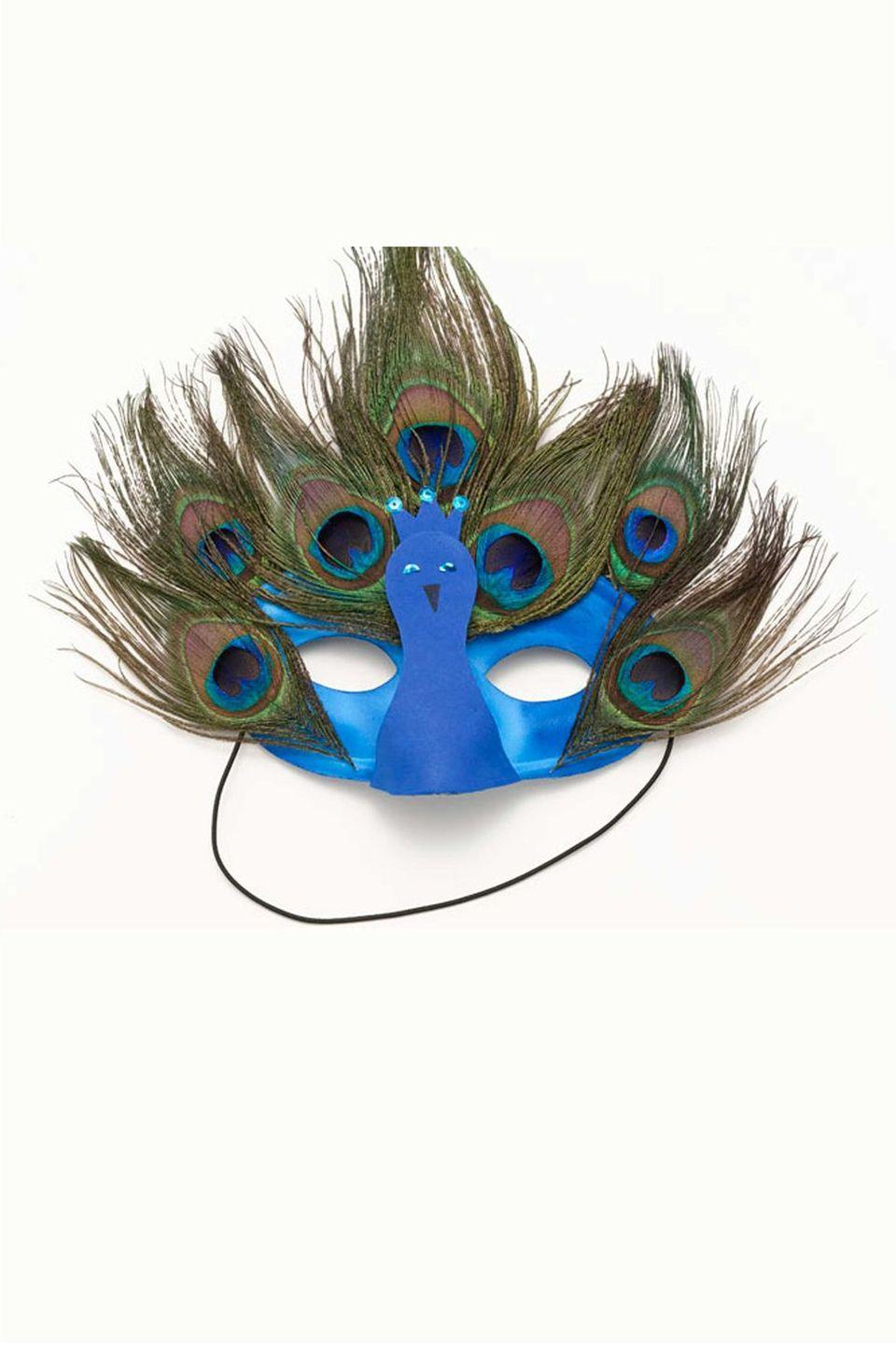 <p>To create this festive peacock mask, glue peacock feathers to a blue mask from the costume store (and for an extra flourish, glue a cute construction paper bird between the eyes). </p>