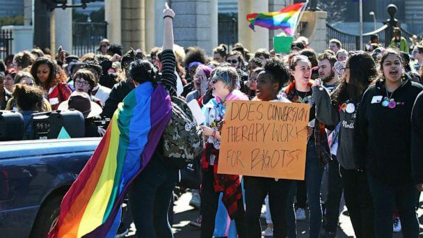 PHOTO: Scores of LGBTQ and allied high school students from across the state of Minnesota march to a rally at the State Cpitol to urge lawmakers to protect LGBTQ Minnesotans and youth from the effects of so-called conversion 'therapy,' March 21, 2019. (Jim Mone/AP, FILE)