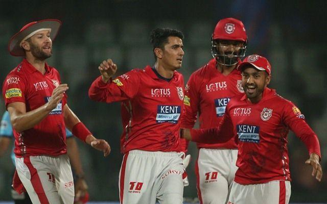 Mujeeb celebrates with his teammates after picking up Rishabh Pant's wicket.