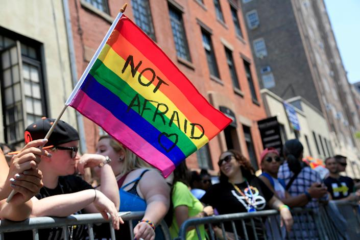 An individual holds a rainbow flag during the NYC Pride Parade in New York on June 26, 2016.