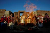 Bolivia's President-elect Luis Arce and vice President-elect David Choquehuanca accompanied by witch doctors participate in an indigenous ceremony at the ancient site of Tiwanaku