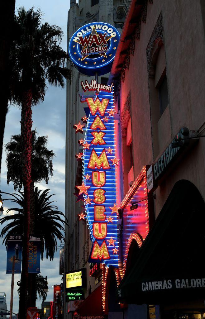 <p>Flashing bulbs illuminate the sign at the Hollywood Wax Museum on Hollywood Boulevard. The iconic museum has been a Hollywood staple since 1965.</p>