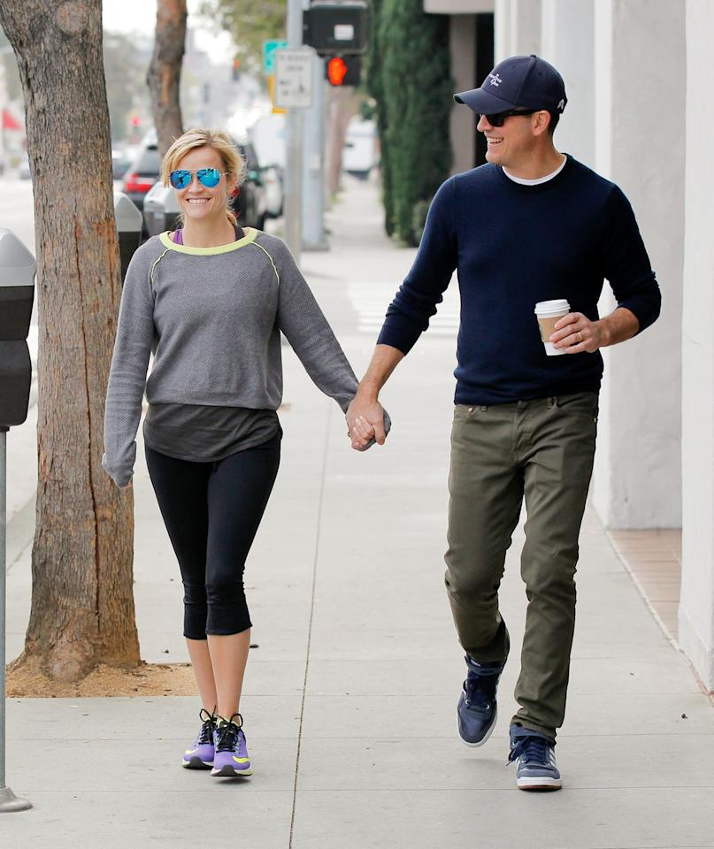"""<p>Two words: """"happy harmony."""" Greer is super into how at ease these two are with each other, as shown by their comfy getups. It also helps that they're sporting giant smiles, holding hands, and stepping forward in sync-a move that points to shared goals, according to Greer.<br></p>"""