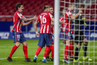 Atletico Madrid's goalkeeper Jan Oblak celebrates with his teammates after stops a penalty kick during the Spanish La Liga soccer match between Atletico Madrid and Alaves at the Wanda Metropolitano stadium in Madrid, Spain, Sunday, March 21, 2021. (AP Photo/Manu Fernandez)