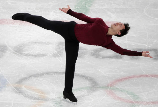FILE - In this Feb. 17, 2018, file photo, Patrick Chan, of Canada, performs during the men's free figure skating final in the Gangneung Ice Arena at the 2018 Winter Olympics in Gangneung, South Korea. Chan, who won his long-awaited Olympic gold as part of the team event at the Pyeongchang Olympics, is retiring after more than a decade on the world stage. Chan made his decision official Monday, April 16, 2018, after alluding to it during the Winter Games. (AP Photo/Julie Jacobson, File)