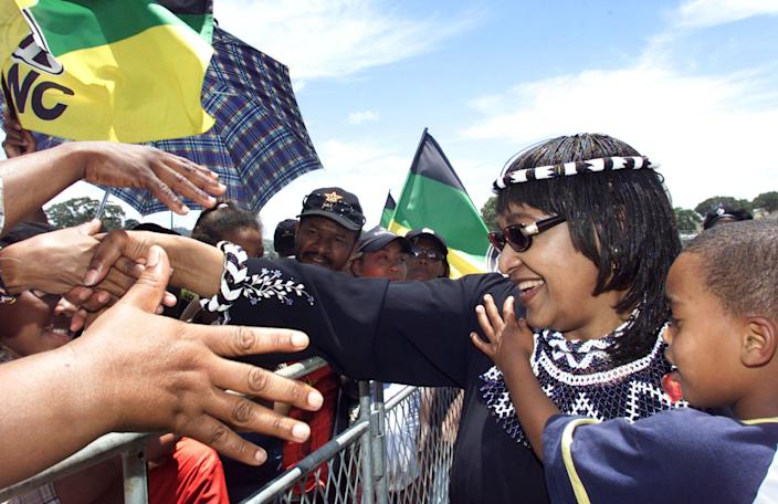 <p>African National Congress (ANC) Womens League President Winnie Madikizela-Mandela greets supporters at the closing rally of the 51st National Conference of the ruling ANC on Dec. 20, 2002.<br> Madikizela-Mandela was elected to a new term on the top decision-making body of the ANC, the National Executive Committee, along with both the secretary general and deputy secretary general of the South African Communist Party. (Photo: Mike Hutchings/Reuters) </p>