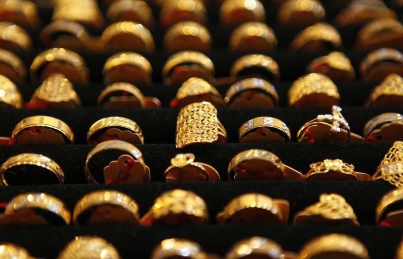 Gold rings are seen on display at a goldsmith shop in Kuala Lumpur