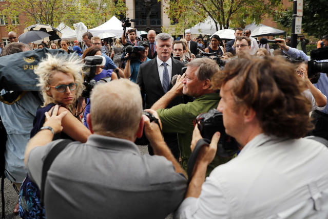 <p>Kevin Downing, a member of the defense team for Paul Manafort, is surrounded by members of the media after Manafort, the longtime political operative who for months led Donald Trump's winning presidential campaign, was found guilty of eight financial crimes in the first trial victory of the special counsel investigation into the president's associates in Alexandria, Va., Tuesday, Aug. 21, 2018. (Photo: Pablo Martinez Monsivais/AP) </p>