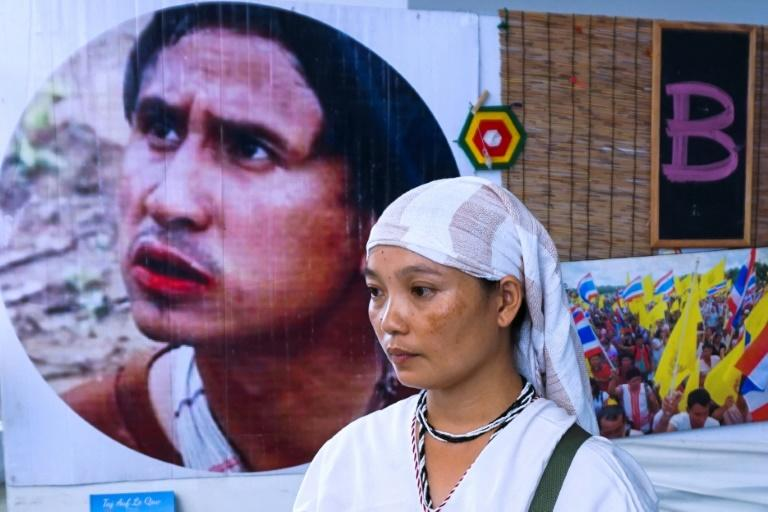 Pinnapha Phrueksapan wiped away tears away at a sombre commemoration ceremony in Bangkok of her husband's life