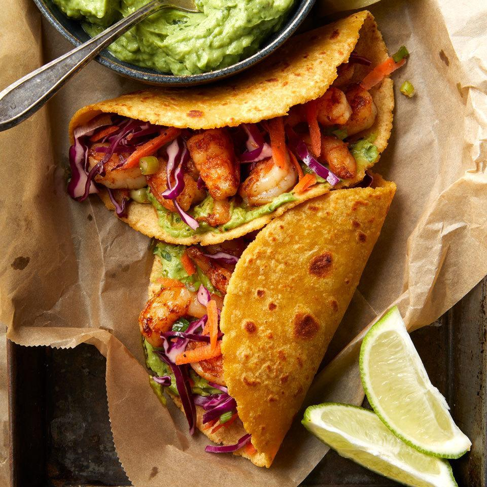 """<p>Avocado cuts some of the sour cream in our quick crema loaded with cilantro, for a healthier taco sauce that takes these shrimp tacos to the next level. Shrimp cook up super-fast, making them the ultimate taco filling for a fast weeknight dinner that's also impressive and delicious enough for a weekend dinner party. <a href=""""http://www.eatingwell.com/recipe/262655/shrimp-tacos-with-avocado-crema/"""" rel=""""nofollow noopener"""" target=""""_blank"""" data-ylk=""""slk:View recipe"""" class=""""link rapid-noclick-resp""""> View recipe </a></p>"""