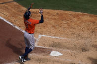 Houston Astros' Carlos Correa reacts after hitting a home run during the seventh inning of a baseball game against the San Diego Padres, Sunday, Sept. 5, 2021, in San Diego. (AP Photo/Gregory Bull)