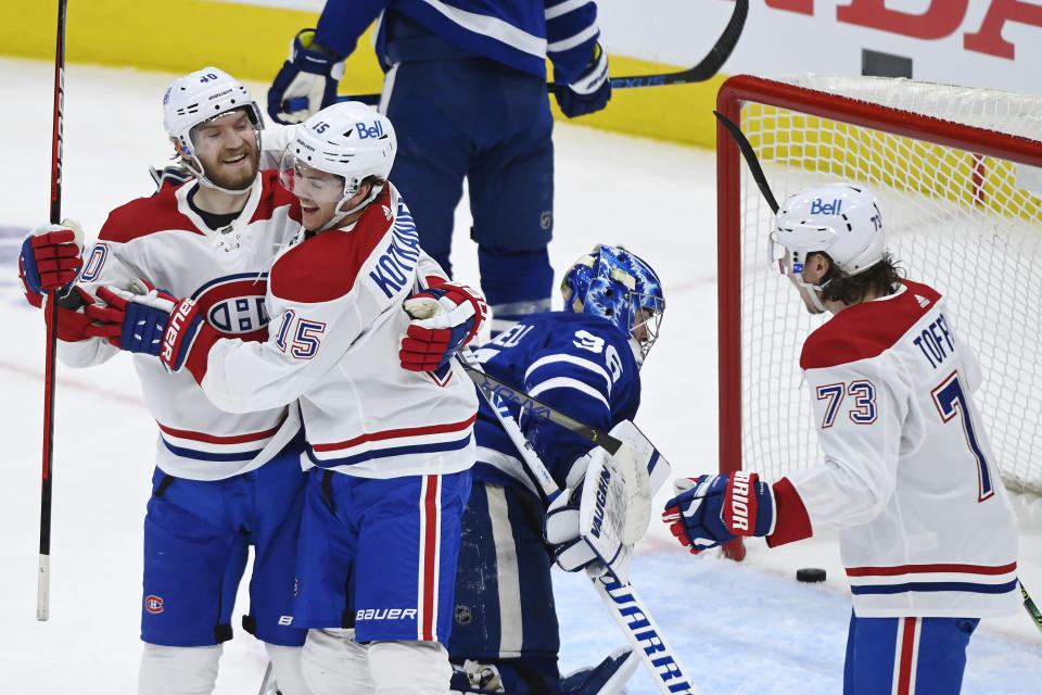 Montreal Canadiens forward Jesperi Kotkaniemi (15) celebrates his goal against Toronto Maple Leafs goaltender Jack Campbell (36) with forwards Joel Armia (40) and Tyler Toffoli (73) during the first period of Game 2 of an NHL hockey Stanley Cup first-round playoff series Saturday, May 22, 2021, in Toronto. (Nathan Denette/The Canadian Press via AP)