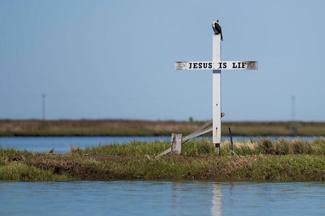 "<p>A cross stands at the mouth of the harbor reading ""Jesus is Life"" in Tangier, Virginia, May 16, 2017, where climate change and rising sea levels threaten the inhabitants of the slowly sinking island.<br> (Jim Watson/AFP/Getty Images) </p>"