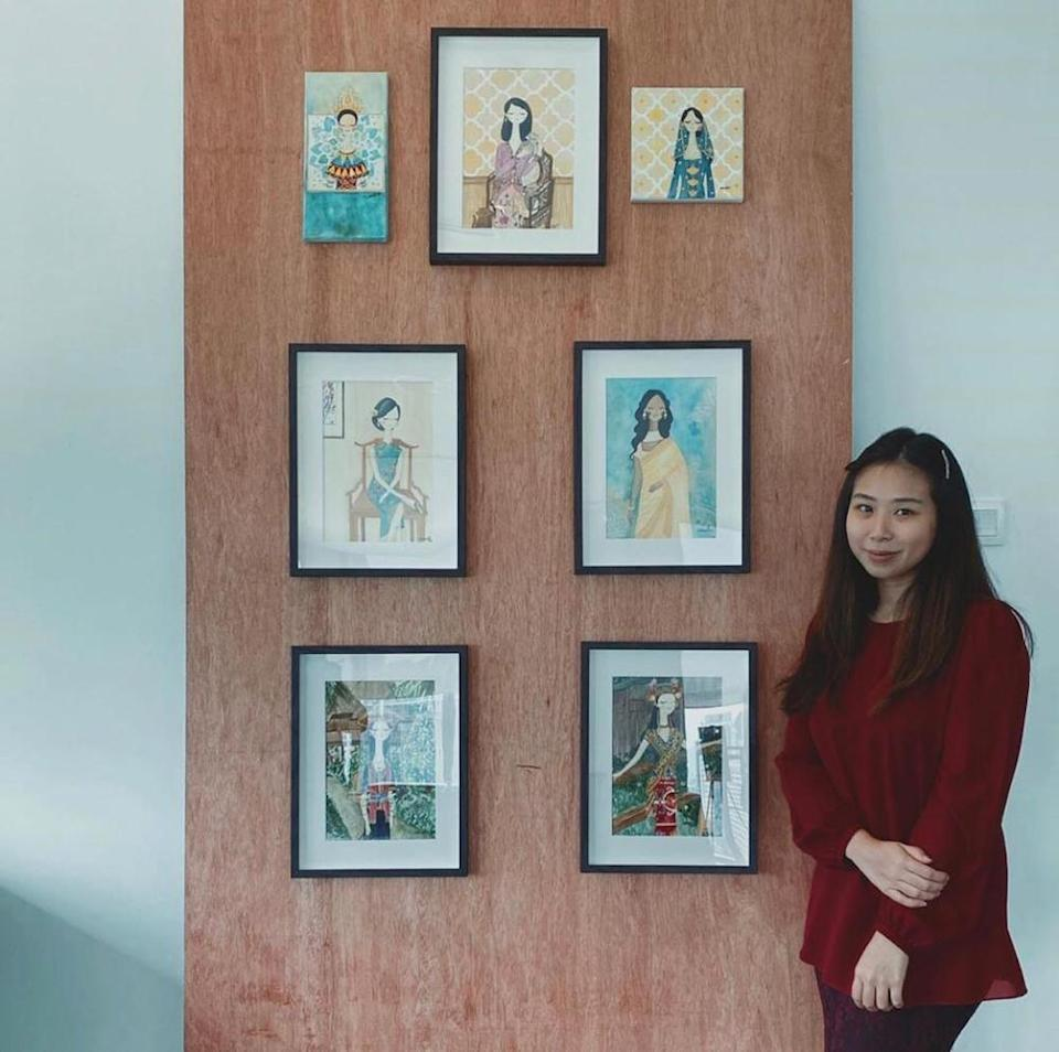 Noor Sarah and her portraits of her artwork featuring Malaysian women and their traditional attire. — Picture courtesy of Noor Sarah Reza.