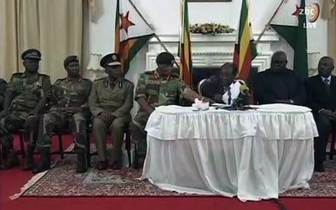 A screen grab of Mr Mugabe's speech shown on the Zimbabwe Broadcasting Corporation - Credit: AFP
