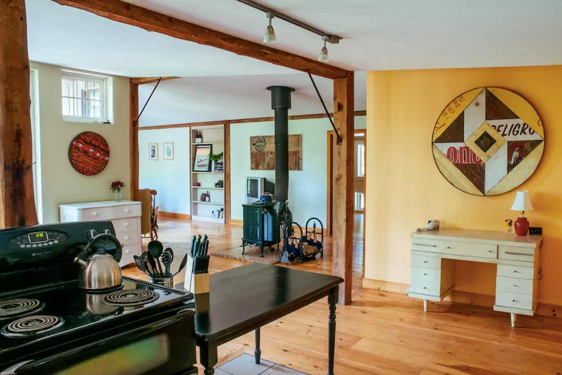 <p>The open-concept farmhouse has plenty of rustic charm with all the modern amenities, including a full kitchen.<br />(Airbnb) </p>