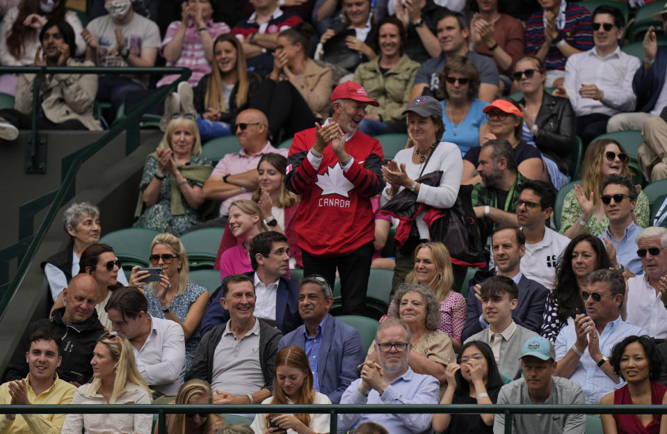 Canadian fans cheer as Denis Shapovalov breaks Karen Khachanov's serve in the fifth set during the men's singles quarterfinals match on day nine of the Wimbledon Tennis Championships in London, Wednesday, July 7, 2021. (AP Photo/Alastair Grant)