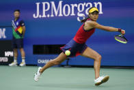 Emma Raducanu, of Britain, returns a shot to Leylah Fernandez, of Canada, during the women's singles final of the US Open tennis championships, Saturday, Sept. 11, 2021, in New York. (AP Photo/Seth Wenig)