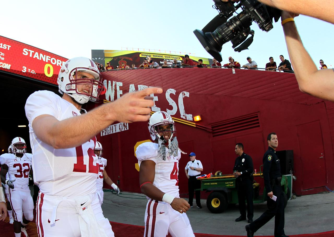 LOS ANGELES, CA - OCTOBER 29:  Quarterback Andrew Luck #12 of the Stanford Cardinal points at a video camera as he takes the field to warm up for the game with the USC Trojans at the Los Angeles Memorial Coliseum on October 29, 2011 in Los Angeles, California.  (Photo by Stephen Dunn/Getty Images)