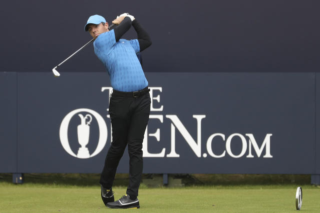 FILE - In this July 18, 2019, file photo, Northern Ireland's Rory McIlroy hits his tee shot on the first hole during the first round of the British Open Golf Championships at Royal Portrush in Northern Ireland. McIlroys opening shot in the first major in his home country in 68 years went out-of-bounds. (AP Photo/Peter Morrison, File)