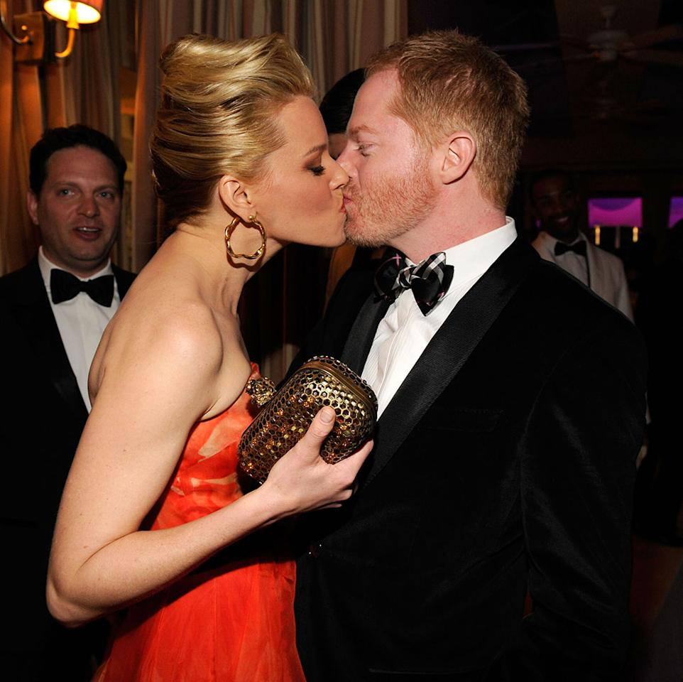 Elizabeth Banks and Jesse Tyler Ferguson attend the 2013 Vanity Fair Oscar Party hosted by Graydon Carter at Sunset Tower on February 24, 2013 in West Hollywood, California.
