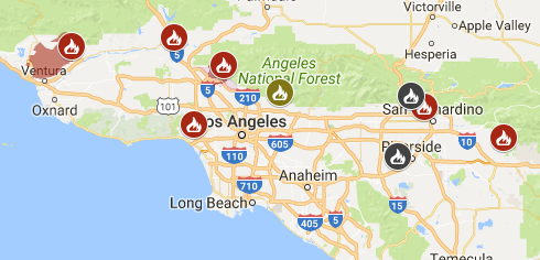 A map of the fires surrounding Los Angeles Wednesday morning. Red and yellow icons indicate a fire that's actively burning. A gray icon marks a fire that's 100 percent contained.