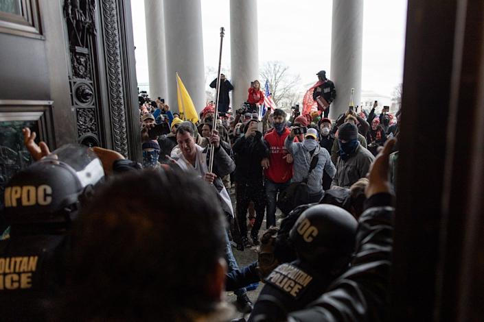Police intervene as Trump supporters attempt to enter the Capitol building on Jan. 6. (Photo: Anadolu Agency via Getty Images)